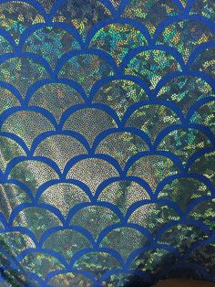 fd8b69e54ec 4 way stretch blue 2 tone jumbo fish scales with green foil on top of it  sold by the yard