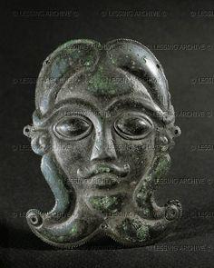 HALLSTATT CULTURE ORNAMENT 5TH BCE Mask of a man with beard. Bronze ornament from a Celtic wooden pitcher. Second half 5th BCE Height 8 cm Keltenmuseum, Hallein, Austria