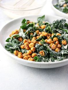 This Vegan Kale Caesar Salad is made with a dairy-free tahini dressing and topped with Garlic Roasted Croutons as a grain-free and protein-packed option.