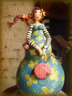 doll gourd. Her arms and head could be done in Polymer clay!