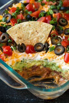 My favorite recipe for Bean Dip! Packed with flavor and always a crowd pleaser. Perfect game day food or party snack. My favorite recipe for Bean Dip! Packed with flavor and always a crowd pleaser. Perfect game day food or party snack. 7 Layer Bean Dip, Layered Bean Dip, 7 Layer Taco Dip, 7 Layer Mexican Dip, Mexican Bean Dip, Seven Layer Dip Recipe Easy, 7 Layer Salad, Easy Taco Dip, Cold Taco Dip