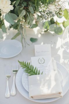 Simple Chic Plate Setting: If in doubt, white it out. Seriously, a clean white plate setting can do no wrong. Slip in a fern with your menu, add a gleaming set of silver utensils and you've got the making for one charming table setting. (via Onelove Photography / Style Me Pretty)
