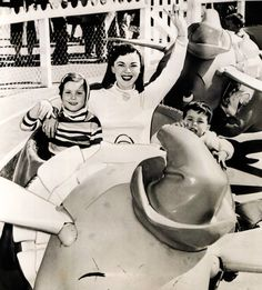 Shirley Temple Black at Disneyland enjoying the Dumbo ride with daughter Susan and son Charles in 1956. The next year she returned to christen the new Sleeping Beauty walk-through inside the Castle. I love Shirley Temple, and I always LOVED that walk through.  I did not know she helped open it though.  Awesome!   Another fun fact, in 1937 Shirley presented Walt Disney with his special Academy Award for Snow White and the Seven Dwarfs. It was a standard-sized Oscar with seven little Oscars…