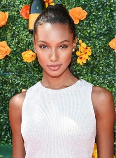 Jasmine Tookes looks ethereal with light, subtle makeup and a pulled-back bun