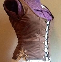 Reversible, Embossed floral print suede bodice, with side laces on hip on Etsy, $50.00