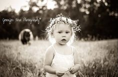 Jennifer Tara Photography  Country girl photo shoot Baby girl in field with flowers in her hair
