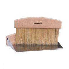Exclusive homewares including table brush and pan in wood by Nicolas Vahe.