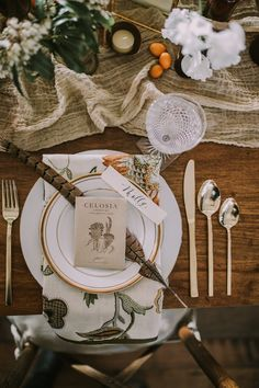pretty place setting with feathers - photo by EmVision Photography http://ruffledblog.com/earthy-farm-to-table-wedding-inspiration-in-nashville