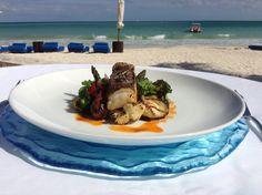 Grilled grouper fillet, jasmine-coconut rice, grilled vegetables, roasted tomato and chile sauce  Filete de Mero y vegetales  a la parrilla , arroz de jazmín y coco, salsa tatemada