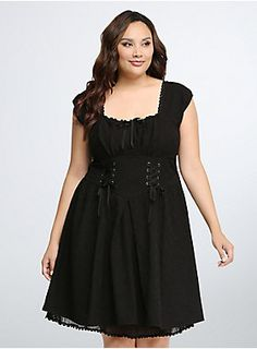 A gothic-inspired style for the modern girl. Embroidered stretchy black fabric paired with a lace up corset front lends an old-world feel. A pleated sweetheart neckline flatters the bust, while a three-tired ruffled back gives the look a jolt of modernity. Lace up back