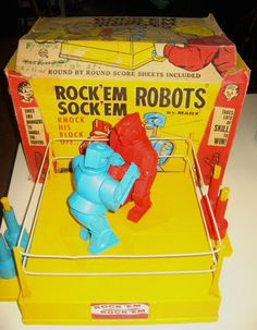 Rock'Em Sock'Em Robots. Two may enter; only one may leave with his spring-loaded head intact.
