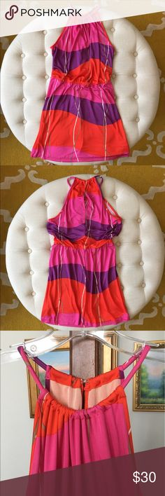 """Trina Turk Silk Blend Halter Dress size 2 So cute for spring and summer!💕☀️ Trina Turk wavy striped halter dress size 2. There is one little shadowy spot on the orange part and a small pick in the fabric on the pink part (see last two picks). Neither is really noticeable because of how the fabric gathers at the top. I myself didn't notice until I listed it. Price reflects. Otherwise in excellent condition ❤️ Hook and eye closure in back, elasticized waist with belt loops. Bust measures 40""""…"""