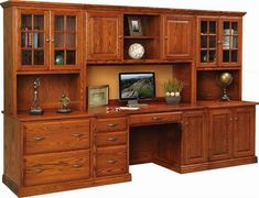 Amish Harrington Office Complete office unit in luxurious solid wood. Includes adjustable shelves, lateral file drawers, drawer dividers, keyboard drawer, raised panel doors, corkboard center and so  much more! Amish made office furniture available in 4 wood types.