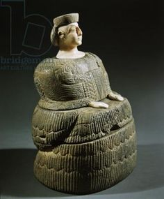 "Statuette of a goddess known as the ""Princess of Bactriane"". She wears a kaunakes skirt patterned to look like feathers or petals, is made of chlorite & calcite, & dates from the 3rd millennium BC from what is today Afghanistan"