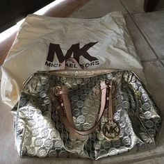 Michael Kors Gold Handbag Very good in the outside but peeling inside. Comes with dustbag. Michael Kors Bags Satchels