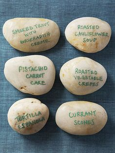 Write menu items on stones and place near the dishes on the buffet table