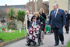 War Veteran from nearby Halsey House care home (Royal British Legion) attending Remembrance Sunday in Cromer, North Norfolk.