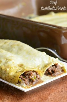 Beef Enchiladas Verde. These amazing Beef Enchiladas Verde are made with ground beef, tomatillos, jalapeno peppers, and cheese and baked in creamy tomatillo sauce.   from willcookforsmiles.com #beef #dinner