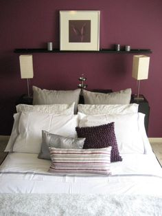 Plum Colored Bedroom. With the white and black.