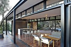 Modern Steel-Framed Home in Johannesburg, South Africa - Steel framing was a natural choice of construction method, as it married the environmental and access requirements to the desired architectural aesthetic. Simply put, we wanted a structure that would touch the Ridge as lightly as possible combined with an elegant, timeless aesthetic that would allow us to use the steel elements not only as primary structural elements, but also as the primary architectural motif.