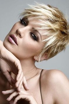 long-ish pixie haircut.. pretty coloring: platinum highlights to neutral brown roots/lowlights.