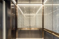 LEVELe-105 Elevator Interior with Capture panels in ViviGraphix Graphica glass with customized Silkworm interlayer and Standard finish, Bonded Bronze with Dark Patina and Rain pattern, Fused Nickel Bronze with Satin finish; Compass handrails in Satin Bronze at Grand Hyatt Washington, Washington, D.C.