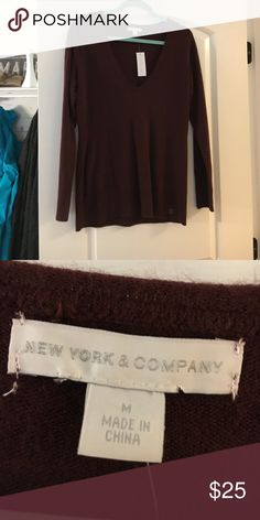 New York and Company Sweater! Never Worn! New York and Company Burgundy Sweater. Never Work! Tags and sticker still on it! New York & Company Sweaters V-Necks