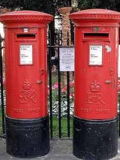 """Do you know which box is older?  (The one on the left. It bears the crest of """"George Rex"""" for King George, Elizabeth's father. The one on the right bears Elizabeth's crest, """"Elizabeth Regina"""" for Queen Elizabeth.)"""