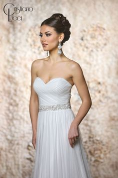 12949/Kristen This gorgeous soft, flowing slim A line dress with ruching drapes bodice and complete with dazzling crystals belt Fabric: Tulle Available Color: Ivory, White