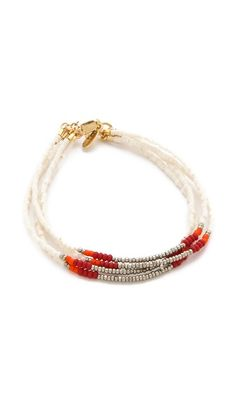 Strands of seed beads add color and polish to this Shashi bracelet. Adjustable length and lobster-claw clasp.