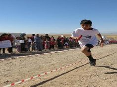 IRAQ: Hundreds of Syrian children ran in the Race for Survival event in Domiz refugee camp in the Kurdistan Regional Governorate (KRG), Iraq.   Save the Children and partner Harikar held the event as part of the Global Day of Action for Child Survival. The race was part of a campaign to promote a hygienic and sanitary camp environment to help protect the health of children under five.