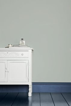 Farrow and Ball.  Skylight  No.205   A definite light blue, works with Parma Gray. White & Light Tones Undercoat.