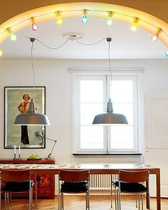 Color lightbulbs in an arched doorway.