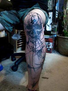 Skull knee tattoo