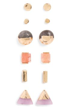 Geometric studs—from classic discs to slender bars to dipped stones—give simple outfits a bit of striking shine.