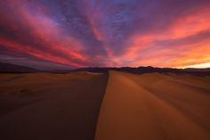 Fiery sunrise over Mesquite Sand Dunes, Death Valley National Park, California. Photo by Mike Mezeul II.