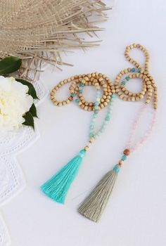 Mala beads + tassel necklaces ..  Amazonite × rose quartz + sandalwood wooden bead tassel necklace with teal tassel and nude / taupe tassel ...  Lots of new listings @ www.brightnewpenny.com