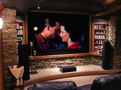 The Stone Pillars and bottom backslash design Surrounding the movie Screen no Shelves or wood for Theater Room