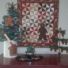 Christmas 2015 - a little Gingerbread vignette.  I'm not pulling out all the Gingerbread decor for our kitchen; this makes me happy! I made the wallhanging a couple of years ago and @sweetpquilting made the Gingerbread wool mat a few years ago as a wonderful surprise.  #gingerbread #christmas2015 #woolapplique #christmasdecor