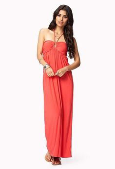 A ribbed maxi dress featuring a self-tie halter neck. Sweetheart neckline. Lightly padded shaped ...
