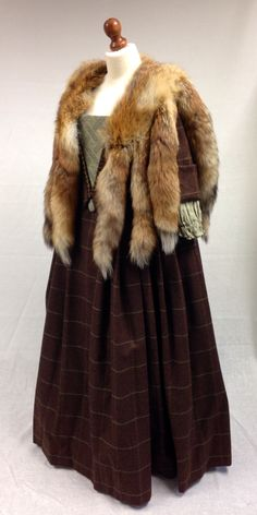 Letitia MacKenzie's red dress with luxurious fox fur cape. | Costume Designer TERRY DRESBACH | Outlander on Starz