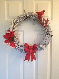 Winter cardinal wreath on a grapevine wreath.  www.facebook.com/candswreaths