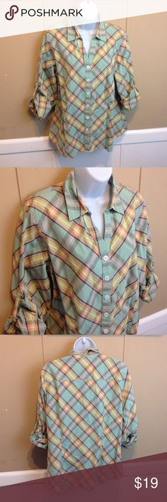 """Van Heusen Mint Green Plaid Button Down Blouse Maker: Van Heusen  ♥ Material: Cotton ♥ Color: Mint Green Plaid ♥ Measured Size: Pit to pit- 22"""" Pit to cuff- I did not measure. They are rolled up but can be worn down. Shoulder to waist- 25"""" ♥ Tag Size: XL ♥ Actual Size: XL PLEASE CHECK YOUR ACTUAL MEASUREMENTS TO MAKE SURE IT IS THE RIGHT SIZE! THANKS! ♥ Condition: Great ♥ Item #: (office use only) Tub A      INSTAGRAM-thehausofvintage1984 Facebook- intergalactic haus of vintage 1984 or…"""