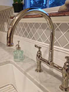 Countertop: Honed Carrara Backsplash: Horus Art Broadway and California Art Tile....want this faucet!!
