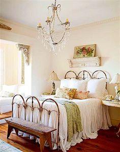 beautifully designed room around this antique iron bed