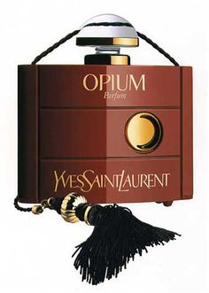 Yves Saint Laurent Opium Original. I still have one of these pendants and the bottle inside minus the perfume used up many years ago..