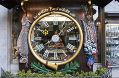 Black Duck sitting on the world's largest Cuckoo Clock in Wiesbaden, Germany Cuckoo Clocks, Vintage Clocks, Ducks, Worlds Largest, Around The Worlds, Germany, Houses, Weather, History