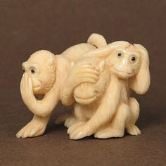 "Mammoth ivory handcrafted ""Three Wise Monkeys"" netsuke, size: 1-5/8"" x 1-3/16"" x 1-1/8"" (42mm x 30mm x 29mm). There are three wise monkeys - see no evil, hear no evil, speak no evil."