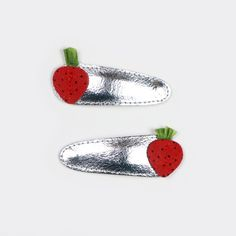 """These strawberry clips evoke warm days and sweet summer fruit, and will brighten up your girl's hairdo any day. 2"""" silver leather clips with sensuede strawberries."""