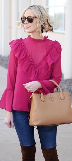 how to style a fuxia blouse : bag + skinny jeans + brown over knee boots